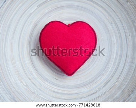 Photo of A bright red heart in the middle of wooden plate with free space around it. Ideal of holidays background, banner, backdrop, wallpaper or can be used for love concept.