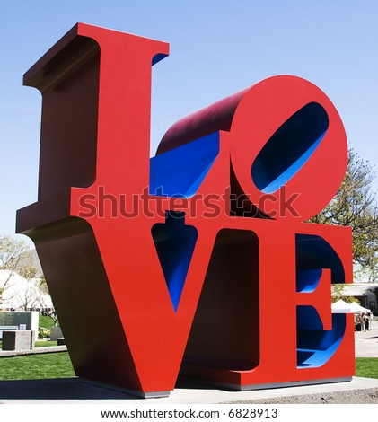 A brightly colored, outdoor sculpture in a public park in Scottsdale, Arizona consists of red and blue letters spelling LOVE.