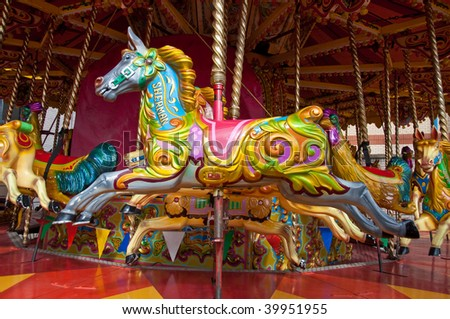 A brightly coloured merry go round horse called Sherman