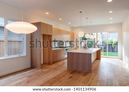 A brightly light modern kitchen with a modern design