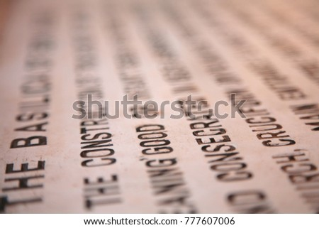 A brightly selected string of letters on several lines of text printed on the surface #777607006