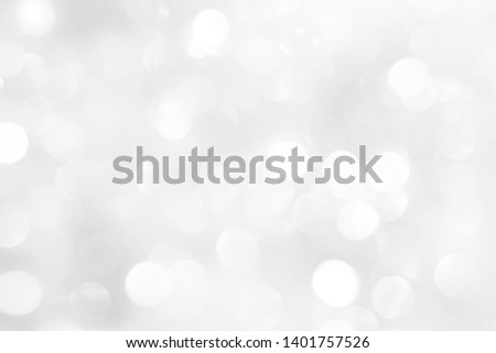 A brilliant white background with circles and ovals. Template for a holiday card with bright and sparkling lights. #1401757526