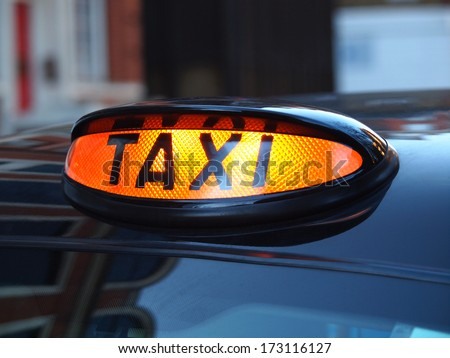 a british london black taxi cab sign  with colorful background         #173116127
