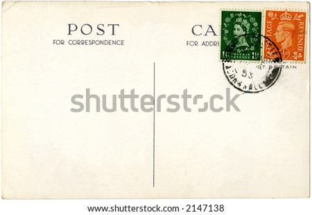 A British postcard from 1953 with stamps showing the old King George VI and the new Queen Elizabeth II