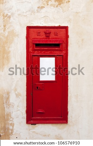 A British wall post box with a ER cipher, representing King Edward VII (from 1902-1910). This example was photographed in Mdina, Malta.
