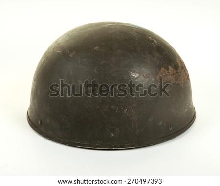A British World War Two period Dispatch Rider or Paratrooper's steel combat helmet on white background
