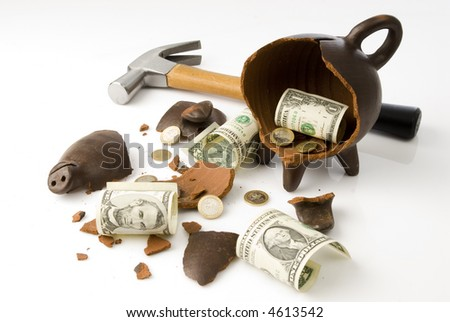 a broken and empty clay piggy money box with money and hammer over white background
