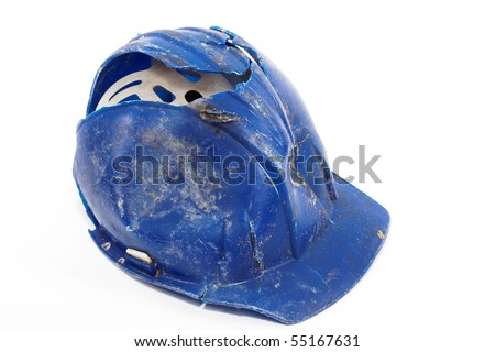 A broken blue protective helmet over white