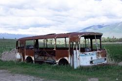 a broken bus left in the woods