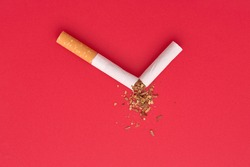 A broken cigarette with scattered tobacco for quit smoking concept.