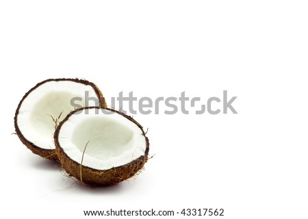 a broken coconut on white background - stock photo