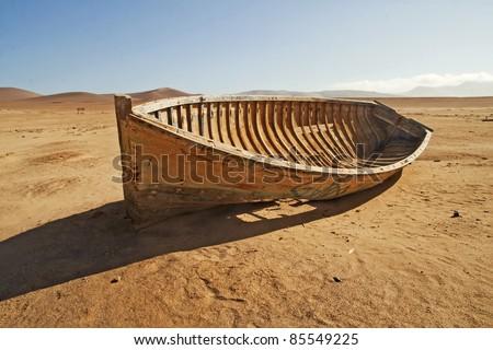 A broken, discarded boat in the desert