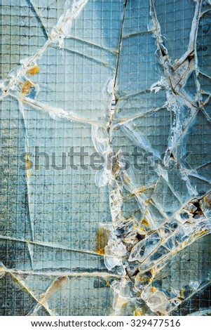 A broken industrial security window.  #329477516