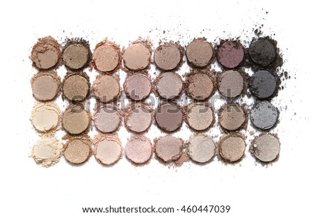A broken neutral colored eye shadow make up palette isolated on a white background