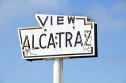 A broken old and abandoned sea-side neon sign that reads View Alcatraz. Located along the waterfront in San Francisco.