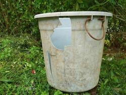 a broken old plastic bucket