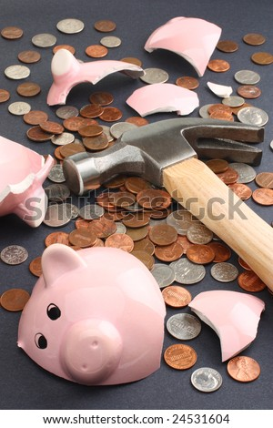 A broken piggy bank loaded with dollar coins. Business & finance concept. - stock photo