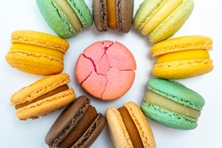 A broken pink cake compared to an unbroken white background. The concept of non-ideality, identity Loss and Broken Soul. macaroon. high quality
