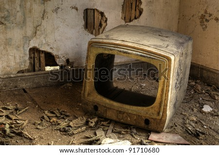 A Broken Television in an Abandoned House - stock photo