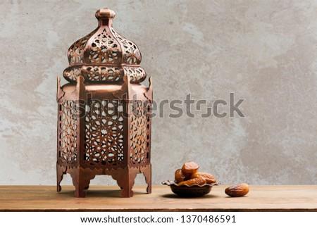 A bronze ramadhan lamp with Islamic rosary #1370486591