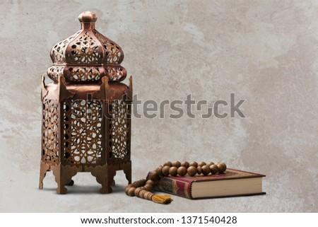 A bronze ramadhan lamp with Islamic rosary #1371540428