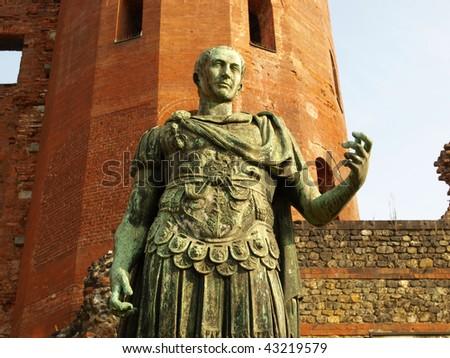 A bronze roman statue in Turin, Italy