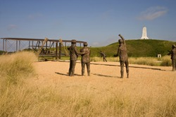 A bronze statue commemorating the first powered airplane flight by the Wright Brothers