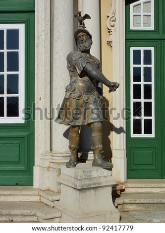 A bronze statue in front of the entrance of  the Queluz palace in Portugal