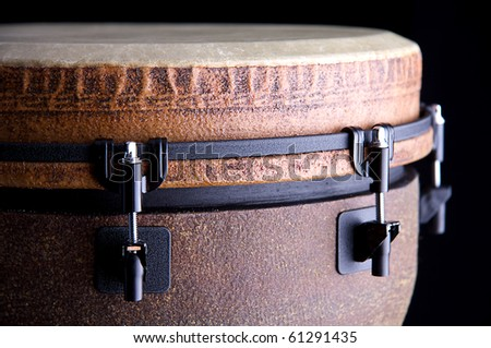 A brown African or Latin Djembe conga drum isolated on black background.