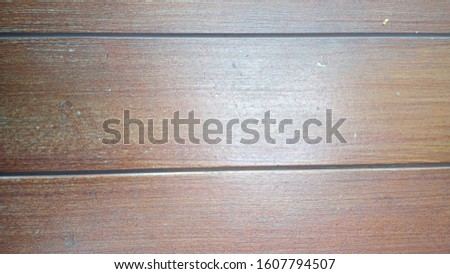 A brown brown bench made from cherry wood