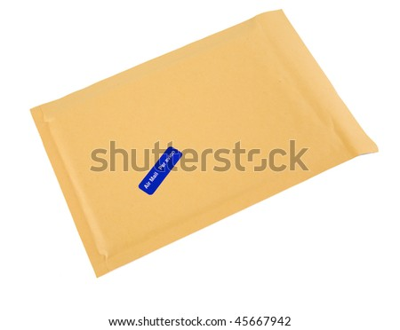 A brown bubble padded envelope with an airmail (in both English and French) sticker attached.
