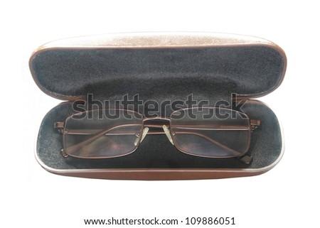 a brown glasses in a box isolated