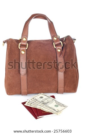 A brown handbag with two passports and money isolated on white background
