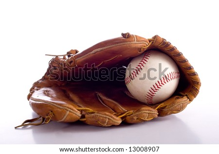 A brown leather baseball glove and a baseball on a white background with copy space