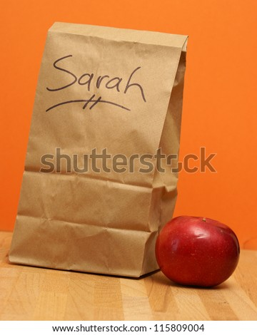 A brown lunch bags prepared specially for Sarah.