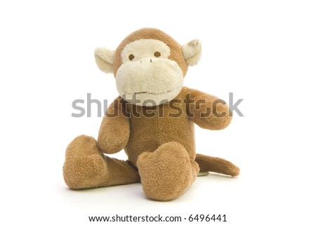 a brown monkey, made of plush - stock photo