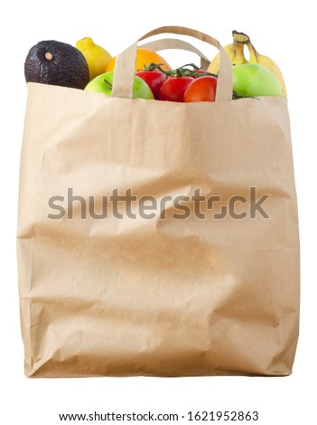 A brown paper shopping bag, filled to the top with varieties of fruit, cut out and isolated on a white background.