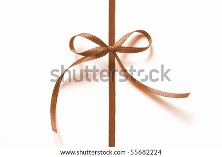 a brown ribbon with bow isolated on white background