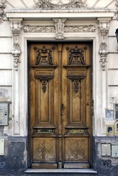 a brown wood old door in the centre of buenos aires argentina