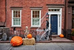 a brownstone building decorated for halloween