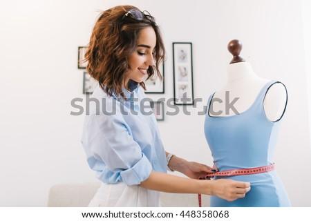 a brunette girl in a blue shirt ...