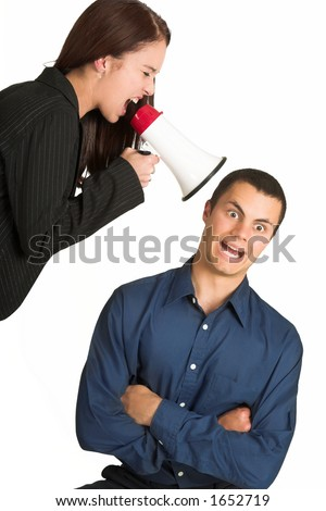 A brunette woman  yelling at her male business partner over a microphone