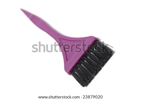 A brush used for dying hair on white background