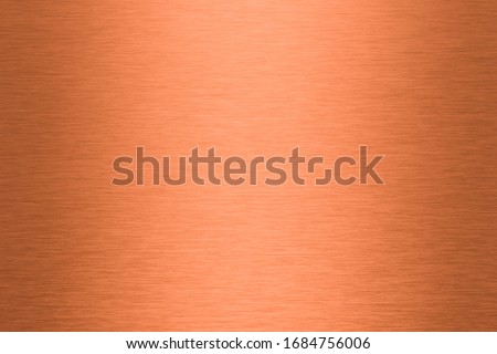 A brushed copper plate as a background Foto d'archivio ©