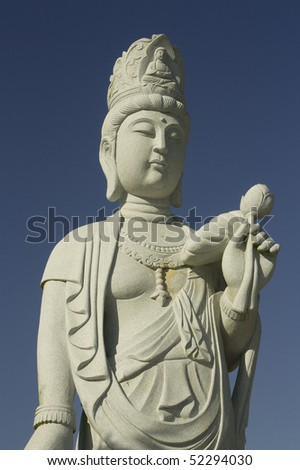 A buddah statue with the blue sky for the background - stock photo