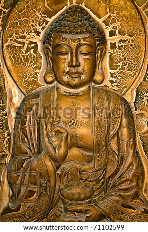 A Buddha sitting on lotus and blessing a lotus urn
