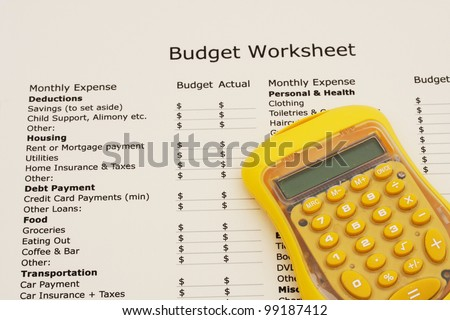 A budget worksheet with a calculator, Creating your budget