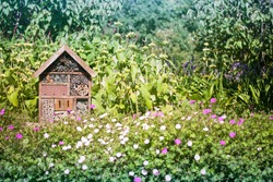 A Bug insect house hotel in a flower field