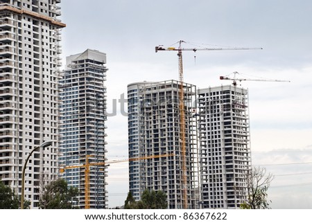 A Building cranes  and buildings  under construction