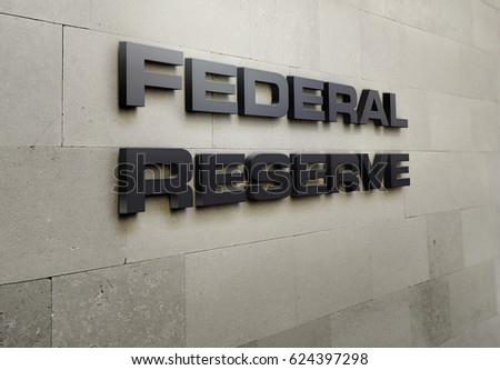A building signage that says 'Federal Reserve'.